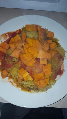 Light tomato sauce with diced sweet potatoes!  And spegehtti squash! 😄
