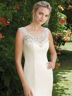 The lovely and feminine Petunia is a perfecting satin gown with princess seams that accentuate the figure. The illusion bateau neckline flows into a scoop ...