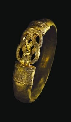 """Christie's will hold their annual Ancient Jewelry auction in New York on December 13. A highlight of the sale is this Hellenistic Period Greek gold bracelet, circa 300 B.C. The piece is hollow and features a central """"Herakles"""" or reef knot that is intricately detailed with twisted wire filigree. More wire filigree and granulation appear on the collars of the bracelet, in natural motifs including palm leaves and tiny birds."""