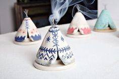 Handsculpted teepee incense burner made out of stoneware clay that releases the smoke through the top of the sticks chimney! The wire sticks were fused to the clay in the kiln, making this a unique mixed media piece. Made for cone incense. This listing is for one navy & white aztec design teepee. When made-to-order, this item will be extremely close to the one pictured but may have subtle differences (giving your piece its hand-made charm!).  Measures Approx: 3.25 diameter 3 tall while on…