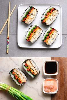 Vegan Sushi Sandwiches / Onigirazu Our vegan sushi sandwiches are a great way to enjoy the taste of sushi while also making it quick and easy to prep your lunch for the days ahead. Vegan Sushi, Vegan Vegetarian, Vegetarian Recipes, Healthy Recipes, Bento, Sushi Sandwich, Sushi Lunch, Sushi Ingredients, Vegan Art