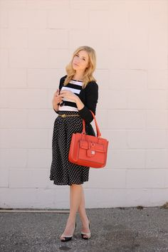 black polka dot skirt, broad striped tee, cardigan and bright purse