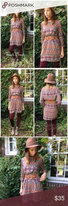 "The Pocahontas Tribal Dress The Pocahontas Tribal Dress  Gorgeous vintage print of earthy colors. Featuring a boat neck line. Elastic waist with a wide elastic removable belt. Sleeves can be worn 3/4 or full length. Pair with leggings. boots and a boho hat for the complete look. Made of Rayon. S, M, L   Small Bust 38"" Length 33""  Medium Bust 40"" length 33""  Large Bust 42""  length 34"" Threads & Trends Dresses"