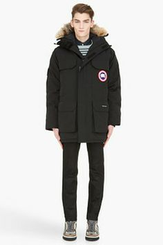 Canada Goose Black Expedition down jacket on shopstyle.com | Long sleeve down jacket in black. Removable fur trim at hood with concealed wire frame. Tonal drawstrings at hood. Two-way zip fly and Velcro closures at front. Patch pockets at exterior arms. Flap pockets, zippered welt pockets, and logo appliqués at front. Textile grab handle at yoke with logo patch. Straight hem. Inset ribbed knit cuffs. Interior zippered welt pocket, Velcroed elasticized gator and bungee drawstring at waist.