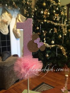 Add a little sparkle to her birthday cake with our super cute Minnie theme cake topper, Pink number (1), Gold Minnie Mouse, Polka Dot bow adorn the topper and accented with pink tulle, Listing is for