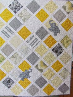 I like the little appliques--cute for a baby quilt