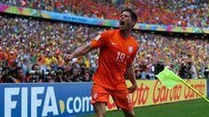 Klaas-Jan Huntelaar of the Netherlands celebrates scoring