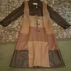 Vintage 100% Genuine Leather Long Coat Vintage leather coat from the 1970's. Has some flaws and damage around some of the buttons.. not all. These can possibly be fixed at a leather repair shop. Also needs to be cleaned.  Deerskin Trading Post. Full lining. - Will take additional photos upon request! **Offers are welcomed** Deerskin  Jackets & Coats