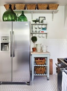 baskets above cabinets to store things you don't use very often. GENIUS.
