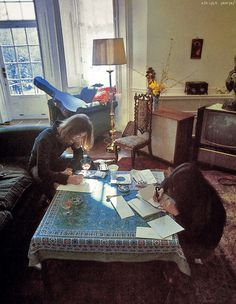John Lennon and Yoko Ono , just chillin at home writing together, photographed by Linda McCartney.