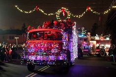 A holiday parade like no other: 265 decorated fire engines, emergency vehicles light up Wallington.