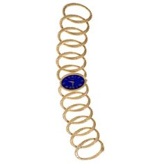 Piaget Lady's Yellow Gold Lapis Lazuli Oval Link Bracelet Wristwatch   From a unique collection of vintage wrist watches at https://www.1stdibs.com/jewelry/watches/wrist-watches/