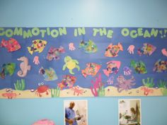 commotion in the ocean bulletin board- tissue paper rainbow fish, handprint octopus and jellyfish