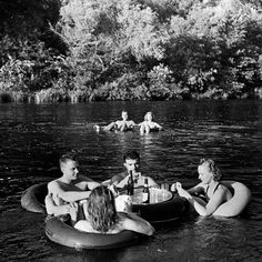 A fun day on the Apple River isn't complete without a floating inner tube table for a game of bridge and a few bottles of beer, 1941. (Alfred Eisenstaedt—The LIFE Picture Collection/Getty Images)