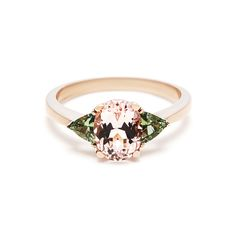 The Tavi ring is a morganite and green sapphire engagement ring set in rose gold made by Porter Gulch in San Francisco.