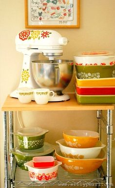 DYI project to decorate KitchenAid mixer to match vintage pyrex. I'm luke warm toward the mixer graphics, but love any excuse to feature these lovely old housewares and their cheerful colors. Who needs Le Creuset? - Home Decorating DIY