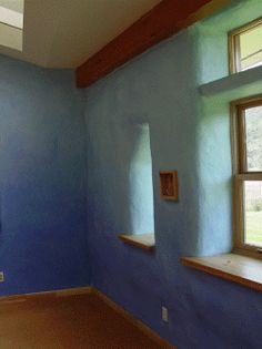 beautiful strawbale. Love the color of the walls.