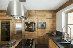 I like the modern rustic kitchen look.