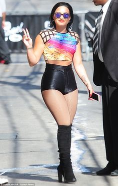 Demi Lovato shows off her pert behind in skintight leather hotpants #dailymail