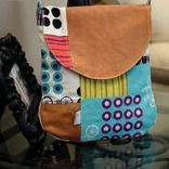 "The Julie Bag by ithinksew -- looks like a basic messenger bag with rounded corners and flap.  Measures 10"" x 10.5 x 1.75"" with a gusset - the Wildwood tote (with gusset) could be modified to make something similar ..."