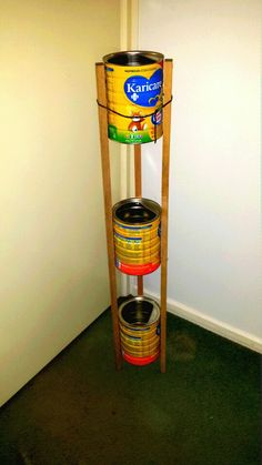 Formula cans upcycled into a stand for the bathroom, unpainted. #upcycle #renewremake