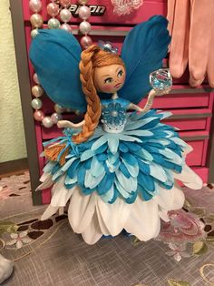 The color doesn't show properly, she is done in vivid turquoise . Fairy Crafts, Felt Fairy, Fairy Clothes, Clothespin Dolls, Chibi, Doll Tutorial, Flower Fairies, Doll Repaint, Fairy Dolls