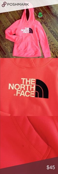 The North Face neon coral hoodie The camera doesn't do the color justice. It's a bright neon coral color. Very cute!  See pic 3 for small black dot only flaw that's barely noticeable. Otherwise like new.  Logo on front and back. Pocket in front. The North Face Tops Sweatshirts & Hoodies