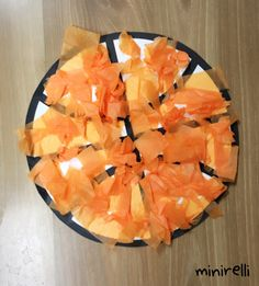 Sports themed crafts are always fun! We love these orange basketballs! That look like they've rolled straight out of the court! You may need: White construction paper Orange tissue paper Glue…