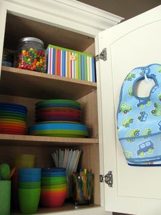 Store bibs on a removable adhesive hook inside the cabinet where you keep the rest of the baby-feeding supplies. - Store bibs on a removable adhesive hook inside the cabinet where you keep the rest of the baby-feed -