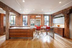 Modern rustic concrete countertops by Trueform Concrete - Reclaimed beams and brick walls