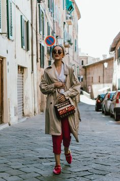 Zara trench coat, topshop tapered pink trousers, gucci logo tshirt, eyelet striped bag, pink fur mules, round glasses, fall outfit ideas 2017, andreea birsan, couturezilla, the popular gucci logo tee from instagram, timeless trench coat, where to find the best trench coats, how to incorporate color into your wardrobe, round ray ban sunglasses, hot pink trousers, how to wear color, how to wear colorful trousers, dressing for fall, fall dressing, what to wear when traveling, couturezilla…