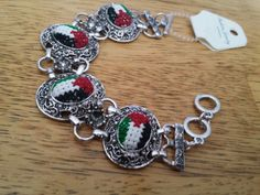 Hand made Palestinian flag bracelet with by PalestinianHeritage Palestinian Embroidery, Palestine, 3 Things, Flag, Hands, Traditional, Stitch, My Love, Awesome