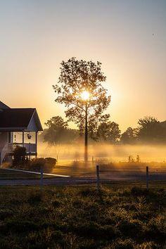 The sun rises over an Amish farm near Shipshewana, Indiana, USA