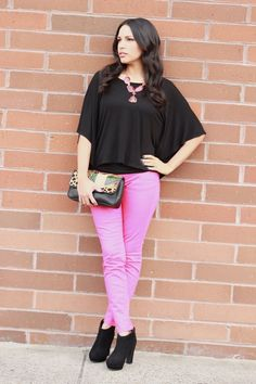 Pink jeans, black top, black booties