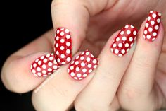 Minnie Mouse inspired nail art for a very girly manicure.