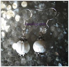Beautiful Handmade Silver Hook Earrings with White Carved Coral Would you like to wear these earrings? Please let me know, thank you :-) You can find these earrings here and other beautiful Jewelry…
