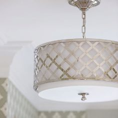 thinking a drum pendant with silver accent would be appropriate in our dining room