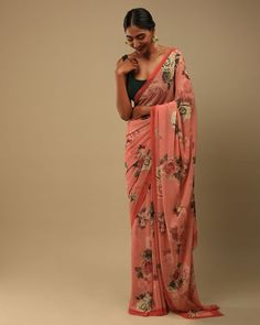 Presenting - 'The Fleur': Sarees for your evening soirees #KALKIGlamFestival✨ Glorify this festive season by gifting yourself this Reddish Peach floral SAREE. Raise the bars high with your flowery look. Fabricated in rich crepe georgette further enhanced in printed rose motifs.🌹 Tag someone who'd look bomb in a Saree💃🏻 Style No M01818360Y-SG69130 Peach Saree, Saree Trends, Georgette Sarees, Saree Styles, Blouse Online, Evening Party, Wrap Dress, Sari, Rose