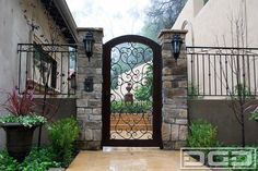 Custom Entry Gates for a Mediterranean Style Home Located in Beverly Hills, CA - mediterranean - front doors - los angeles - Dynamic Garage Door