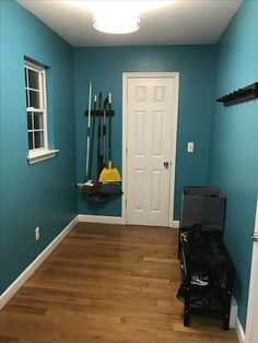 My Mudroom makeover, Behr empress teal, love how the black and white pops against the color