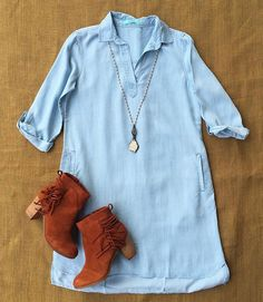 New arrival! ✨ We are in LOVE with our new chambray stripe dress!  | Chambray dress $94 | Cognac fringe booties $129 | Necklace by Bonnie $119 | #newarrivals #fringe #falldresses #getinmycloset #juneandbeyond #shoplocal #417