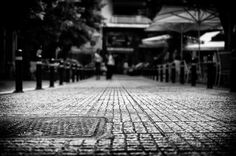 I preferred to focus on the pavement.I am very interested in the details of the ground. Street Photographers, How To Level Ground, Pavement, Athens, Greece, Sidewalk, Pictures, Photography, Shots