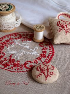 Penty de Val - love cross stitching a monogram then making a button out of it.