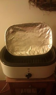 """I saw this HOT tip today...  """"I have a roaster large enough for a turkey. I insulated the lid with a layer of foil and have a small rack to set pans on the inside. I been able to bake in my porch avoiding heating my house up with the oven. For things like brownies that dry out easily I set my pan on the small cooling rack in the roaster and add a few tablespoons water while baking. Just keep an eye on things as cook times may be slightly longer but not heating the house has been great."""""""