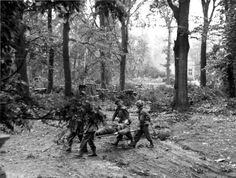 British soldiers carried the wounded on stretchers during the battle near the hotel 'Hartenshteyn' (Hartenstein) in the Dutch village of Oosterbeek
