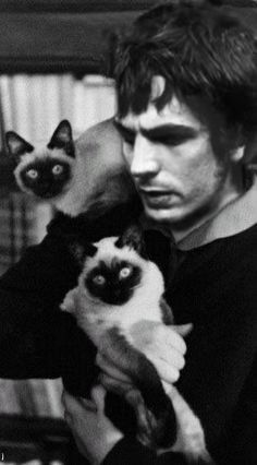 Syd Barrett (Pink Floyd founder) with his two Siamese he also had a ginger tabby. Percy, Sam and Jenniffer (tabby)