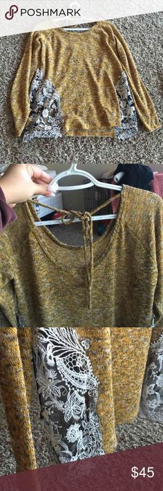 Thin Sweater Never worn. NWOT. From Buckle. Sides have black see through sides with lace flowers. Paid over $70 for it. Price is firm! Low back with tie in the back. Adorable for winter! SIZE: large Buckle Sweaters Crew & Scoop Necks