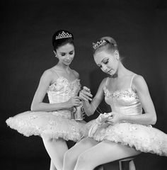 "Kay Mazzo and Suki Schorer sewing ribbons on shoes, in a New York City Ballet production of ""The Nutcracker."" (New York)"