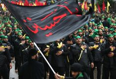 "Lebanese Shiite Hezbollah supporters beat their chests while chanting Imam Hussein slogans during the holy day of Ashoura, in the southern suburb of Beirut, Lebanon, Tuesday, Nov. 4, 2014. Shiites mark Ashoura, the tenth day of the Islamic month of Muharam, to commemorate the Battle of Karbala in the 7th century when Imam Hussein, a grandson of Prophet Muhammad, was killed in present-day Iraq. Arabic on the flag reads, ""Oh Hussein."" (AP Photo/Hussein Malla)"