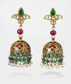 Floral motif domes suspended from a trefoil element set with diamonds and an emerald. From India.